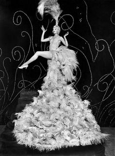 """Aug. 20, 1925: Claire Luce, a famous American dancer, donned the """"famous feather costume of Mistinguett,"""" a famous French dancer, in Paris. Photo: The New York Times."""