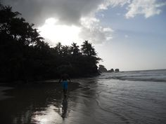 Walking on the beach of L'anse Mitan, Blanchisseuse, Trinidad and Tobago, W.I.