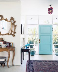 Southwestern rug paired with acqua front door