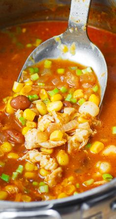 White Chicken Chili with Pinto Beans, Chickpeas, and Corn. Topped with Mexican (or Cheddar) shredded cheese, crushed tortilla chips, and sour cream. Easy and delicious!
