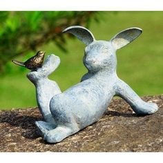 """Playful Rabbit Garden Statue by SPI. $61.99. Bring Spring Right into Your Home or Garden. Whitewashed Verdi Finish with Bronze Colored Bird. Aluminum. 12.5"""" Wide. A Whole Lotta Cute. 33674 Features: -Aluminum construction."""