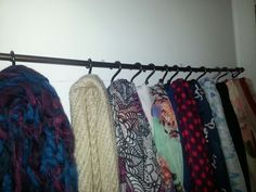 Use a curtain rod and shower hooks to display scarves