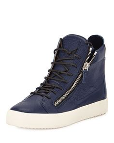 """Giuseppe Zanotti pebbled leather sneaker. 1"""" rubber sole. Round toe. Lace-up front. Tonal logo patch on tongue. Zipper details at sides and counter. Leather lining. Made in Italy."""