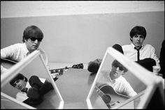 John Lennon and Paul McCartney (mirror images)