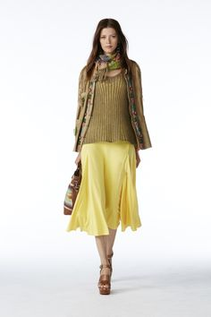 POLO Women Spring 2015 collection: Tan beaded suede jacket, tan silk blend sweater, yellow silk dress, multicolor woven serape tote, and dark saddle washed vachetta studded sandal