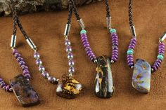 Boulder Opals from Queensland, Australia complimented with Mohave Purple Turquoise, Sterling Silver and Braided Leather.  Contact me for availability.  By Laura Ingalls Designs.