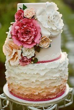 Love this ombre floral wedding cake. Would like to do something similar with gold ribbon maybe.