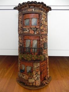 Rock tower faerie house- cover a Pringles cannister? Would be cute in the yard amongst the plants! - DIY Fairy Gardens