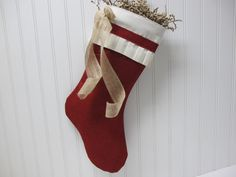 Shabby Chic Christmas Stocking in Red Burlap with hand folded pleats and burlap bow by TurnbowDesigns on Etsy https://www.etsy.com/listing/104235275/shabby-chic-christmas-stocking-in-red