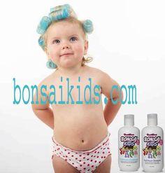 Beautiful girl in curlers kidsshampoo-kidsconditioner-kidsdetangler-kidsgel