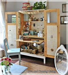 Town and Country Living: Ikea computer Armour transformed into a crafting cabinet...perfect for small living spaces and you can close the doors to hide unfinished projects and mess! Brilliant!