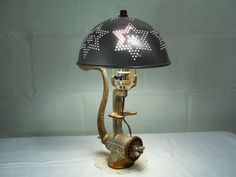 Change the lamp shade to an vintage strainer/colander