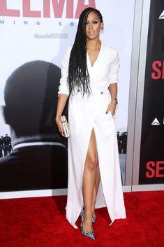 Tia Mowry attends the premiere of Selma in A Tuxedo Dress