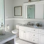 Muble bathroom vanity, white double bathroom vanity, marble ocuntertops, double sinks, chair rail, bathroom chair rail, white bathroom mirror, bathroom art, beachy art, beachy bathroom art, beachy bathroom, seaside bathroom, glass shower, marble tiles, marble tile floor, marble bathroom floor, built-ins, bathroom built-ins, bathroom built-in cabinets, Restoration Hardware Dillon Single Sconce,