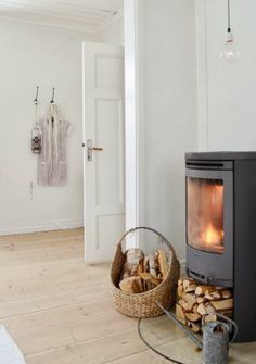 """42 Lovely Scandinavian Fireplace To Rock This Year. A stone fireplace design your pioneer ancestors would envy is the """"Multifunctional Fireplace. Modern Wood Burning Stoves, Modern Stoves, Scandinavian Fireplace, Scandinavian Living, Home Living Room, Living Room Designs, Living Spaces, Living Area, Stone Fireplace Designs"""