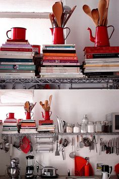 organized small space kitchen- perhaps shelves with recipe books and decorative items + idea for utensil storage