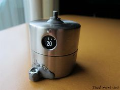 DIY - How to Make 360° Time Lapse Photography   http://davewirth.blogspot.com/2012/04/diy-how-to-make-360-time-lapse.html  How to use a kitchen timer from Ikea to make 360 degree time lapse photography.  1/4-20, heavy, ikea, JB Weld, kitchen timer, metric bolt, nut, ordning, photo, rotates, spring, time lapse, torque, tripod