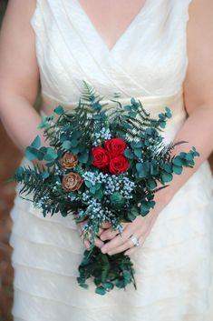 Consists of preserved red roses, cedar roses, preserved bracken fern, preserved spiral eucalyptus and preserved blueberry juniper. - Wrapped in a twine. Please note measurements are approximate as we work with natural florals and handmade products that vary slightly in size and color. Our blooms are handmade per each order so therefore they are nonrefundable.