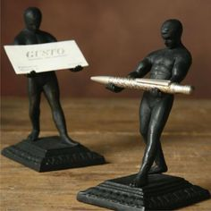 """The perfect desk accessory. The Strong man card holder is made of cast iron. measures 3.5 x 4 x 5.5"""""""