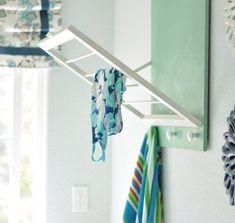 2282059060921022147379 OOO perfect for small spaces DIY Laundry Room Drying Rack  Centsational Girl