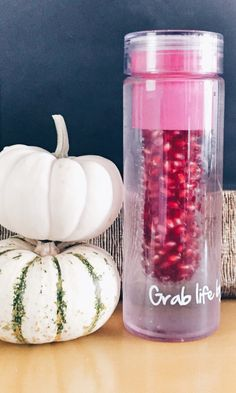 Upgrading my water routine by filling my FabFitFun fruit infuser water bottle with pomegranate seeds.