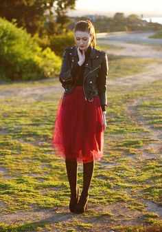 red, tulle skirt + black leather jacket love mixing girly with rocker or punk or masculine