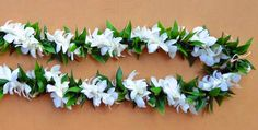 Maile Style Ti Leaf twisted with 2 White Orchid Lei