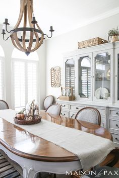 Love the wine barrel chandelier and the lovely grey French farmhouse dining room! Beautiful summer home tour with lots of whites, raw…