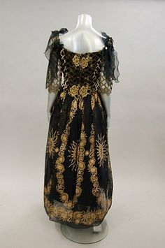 A Zandra Rhodes black and gold ball gown, 1980s, labelled UK size 12, with lattice effect lace bodice and floral stencilled skirt. Back
