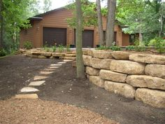 A retaining wall is a perfect DIY project for a variety of skill levels. We have rounded several retaining wall ideas to decorate and build your landscape. Large Backyard Landscaping, Stone Landscaping, Landscaping Retaining Walls, Landscaping With Rocks, Stone Backyard, Terraced Landscaping, Landscape Timber Edging, Landscape Timbers, Landscape Design
