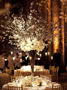 ESCORT CARD TABLE: White cherry blossom branches with rose, peony, and hydrangea base.