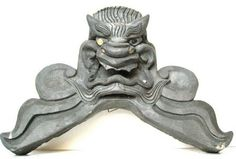 """Antique Japanese black ceramic Onigawara roof tile with large face of Oni. Edo period. (Early 19th Century) Size: 22"""" Wide x 16"""" High x 6"""" Deep"""