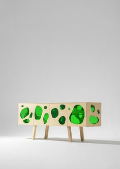 The Campana brothers have used coloured glass to fill blob-shaped gaps in this wooden cabinet for Spanish brand BD Barcelona Design.