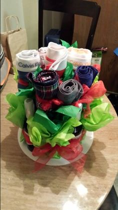 Valentine's day for him: Beer&Boxer bouquet!  What guy doesn't need boxers&alcohol? Lol.... You need- :cake separators :the foam you use to create fake flower center pieces :chopsticks (plastic) :ribbon :tissue paper :tape And of coarse beer and boxers.  I got the crafts from Hobby Lobby, boxers from tjmaxx and target, and beer from a grocery store.