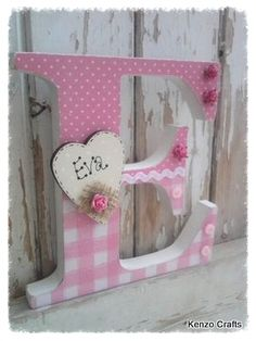 These letters look fabulous in any girls bedroom Painted in off white and shabbed up Decoupaged in pink papers Ric Rac Small wooden heart can be
