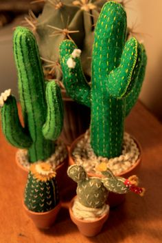 Look at this adorable saguaro cactus! Even more low-maintenance than a real live one and it stays in bloom all year round! DETAILS Made of felt, yarn, embroidery thread, and a flower pot. Height of cactus: 9.5