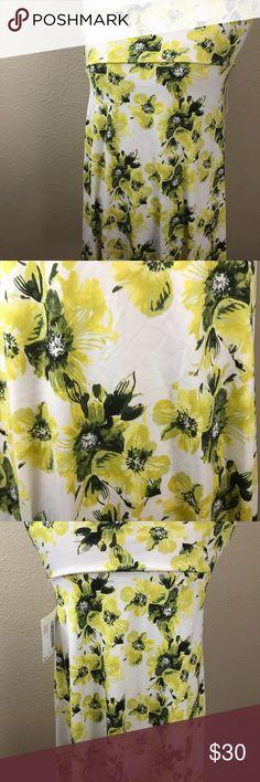 "LuLaRoe NWT Azure // Yellow and Black Flowers NWT LLR Azure // White background with yellow and black flowers. Fabric : ITY ""Slinky"" Material LuLaRoe Skirts Midi"