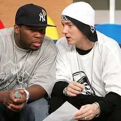 Eminem Photos - Rappers 50 Cent (L) and Eminem appear onstage during BET's 106 & Park December 2006 in New York City. - BET's 106 & Park Presents 50 Cent & Eminem 50 Cent And Eminem, 50 Cent G Unit, Rapper 50 Cent, New Eminem, Shady Records, Eminem Photos, The Real Slim Shady, Eminem Slim Shady, Hipster Outfits Men