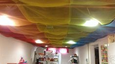 Our unfinished basement ceiling toy room \ playroom.. All done out of yards and yards of tulie.. Next comes the paint...