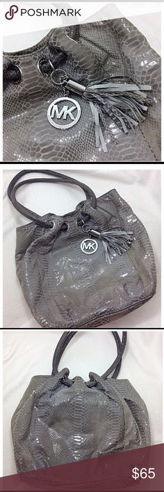 Michael Kors Bag Michael Kors Gray Snakeskin Bag with grommeted handles and matching tassel embellishment. No stains rips or holes Has logo lining and magnetic closure. 11.5'H x 13'W x 3.5'D. Handles hang 9'. Offers are welcome! KORS Michael Kors Bags Shoulder Bags