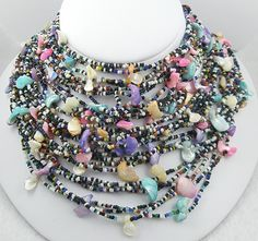 glass seed beads and pastel shells 30-strand torsade necklace