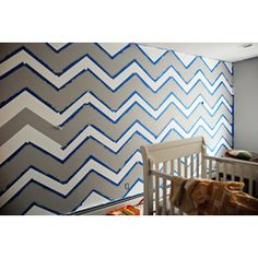 DIY Nursery - Chevron Wall   I was thinking about doing this if we have a boy.... but is looks like SO much work...