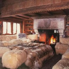 Warm up by the fire in the drawing room of this fabulous chalet in Gstaad. In other Swiss news.the first edition of PAD Geneva opens today! Bungalow Living Rooms, Simple Bedroom Design, Fur Bedding, Colorful Bedding, Bedroom Fireplace, Cozy Fireplace, Cozy Cabin, Design Case, Cool Rooms
