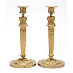 circa 1900, caryatid form spiral foliate decorated columns with foliate and acanthus decoration to bases, removable bobeches.