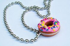 Polymer clay donut necklace.