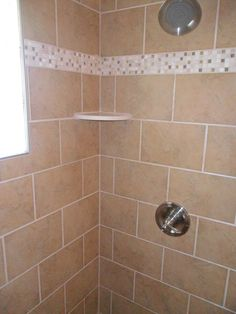 Tiled Shower with marble corner shelf, tile by Shaw, and Decorative Strip of travertine and glass from International Wholesale Tile Tile Projects, Corner Shelves, Travertine, Master Bath, Natural Stones, Tile Floor, Flooring, Tile Showers