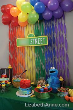 sesame street cake table with count's cupcakes, elmo's goldfish, cookie monster's cookies, and big bird's gummy worms. #sesamestreet #firstbirthday #elmo #birthdayparty