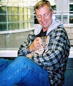 "PFC. HAMMER THE CAT     Sgt. Rick Bousfield holds Pfc. Hammer, the Iraq-born cat that joined his infantry company in Iraq. The Executive Committee of TheraPet, Inc. voted to award Pfc. Hammer its first Honorary Membership ""for services rendered  to those serving in Iraqi Freedom."" Hammer used to make supply runs with the soldiers serving in the war. While the soldiers kept Hammer safe inside their body armor, Hammer kept the soldiers safe from the mice in the mess hall."