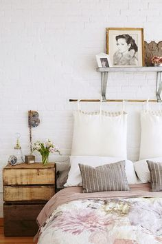 10 Unusual Things to Use as a Headboard From SF Girl by Bay, possibly the weirdest idea on here (and the most comfortable): giant pillows (at least, they look like pillows?) suspended from a copper bar. Soft and also striking.