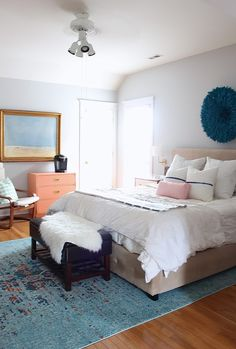 Gorgeous take and blush master bedroom.